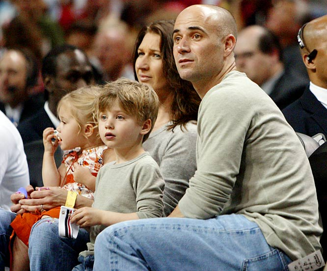 Steffi Graf and Andre Agassi take in a Kings-Heat game during a trip to Miami.