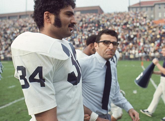 Franco Harris and Paterno walk off the field after a game against Syracuse.