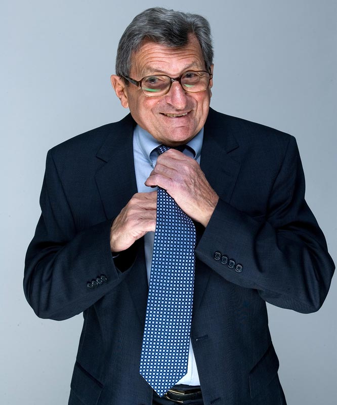 The Penn State coach adjusts his tie during an April 2008 SI photo shoot.
