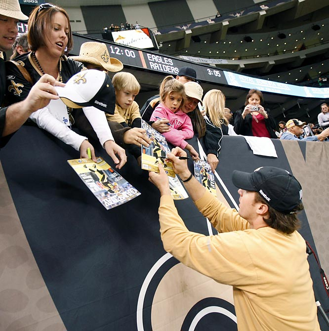Hours before the Saints signature win over the New York Giants, Drew Brees autographed pictures for some of his adoring fans. Here are some more Outside the Huddle shots of the prolific New Orleans quarterback.