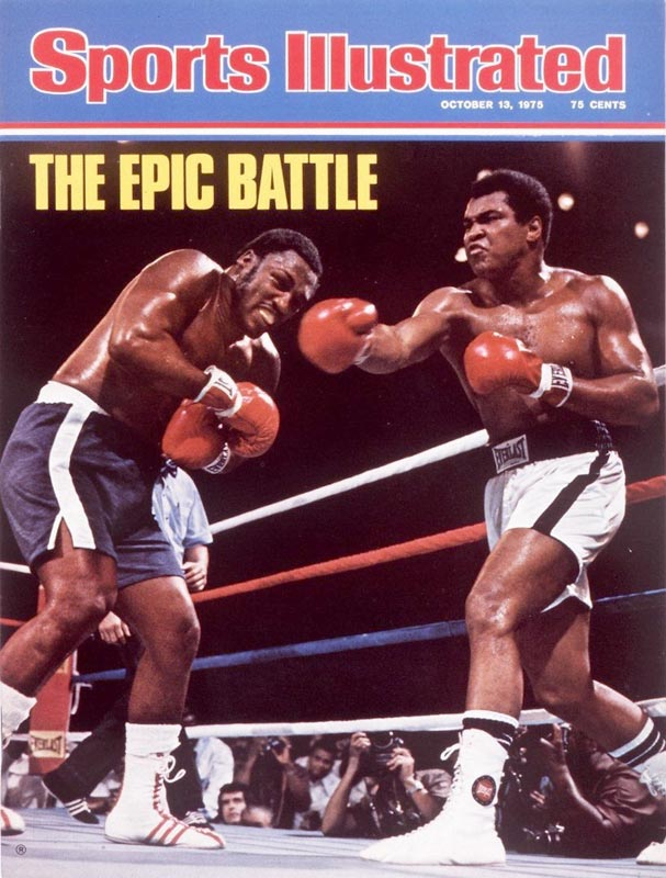 In the famous Thrilla in Manila, Muhammad Ali beats Joe Frazier iby TKO in the 14th round to retain the WBA/WBC Heavyweight titles.