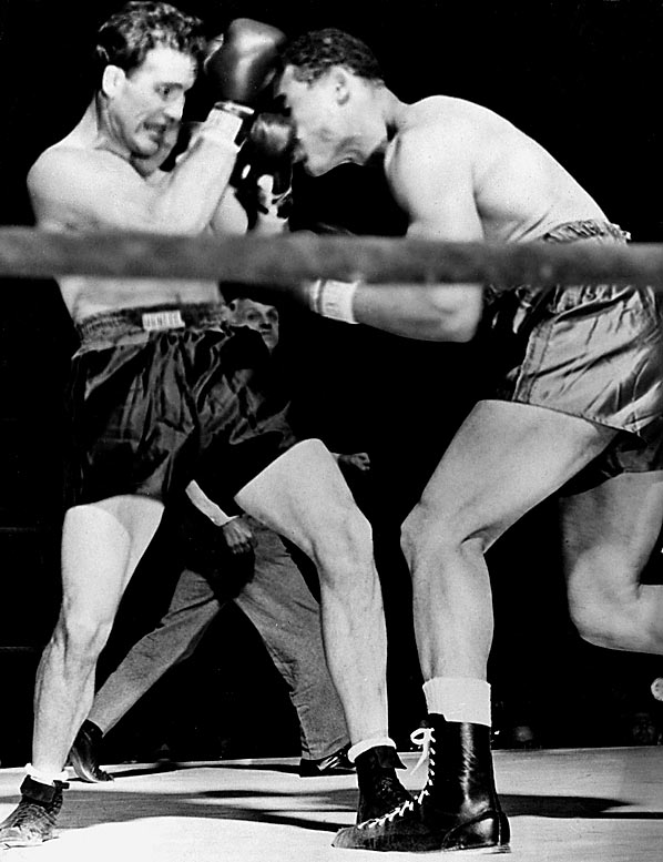 "Legendary heavyweight champion Louis was in the middle of his Bum of the Month Club run when he took on former light heavyweight titleholder Conn at the Polo Grounds. Though outweighed by at least 25 pounds, Conn outboxed Louis throughout and staggered the bigger man late in the 12th round. Rather than coast to victory, though, Conn went for the KO in the 13th. He was caught by Louis and counted out with two seconds left in the round. When revived, a rueful Conn said, ""What's the use of being Irish if you can't be thick?"""