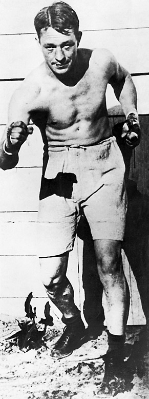 """Known as the """"Michigan Assassin,"""" Ketchel was described by contemporaries as """"savage,"""" """"reckless,"""" """"a demon of the roped square,"""" """"supremely confident,"""" """"a killer,"""" and, indeed, """"the greatest middleweight who ever lived."""" His career was cut short when he was fatally shot at age 24 in 1910, still in his prime."""