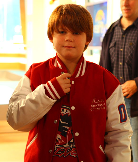 Austin's new jacket was just the right fit since he could still wear his hockey sweater underneath.