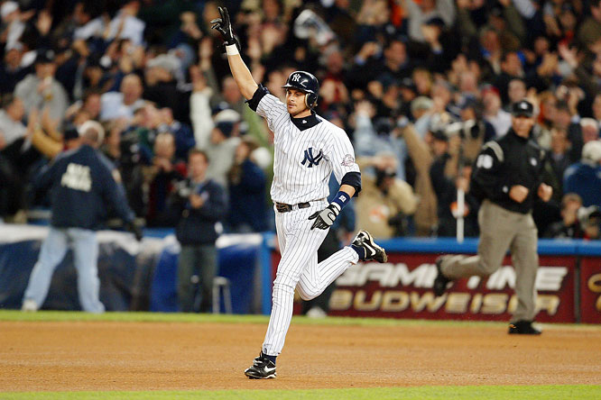 The rivals have combined for six AL pennants and four world championships in the '00s, and their first postseason confrontation of the decade lived up to the hype. Upstaging Roger Clemens, Pedro Martinez got the Red Sox within five outs of the pennant, but Boston manager Grady Little was too slow with his hook and the Yankees, buoyed by a pair of Jason Giambi homers and three scoreless innings of relief from Mike Mussina, rallied to tie it in the eighth. Mariano Rivera pitched three scoreless innings of his own before Aaron Boone finally won the pennant with a walk-off home run off Tim Wakefield on the first pitch of the bottom of the 11th.