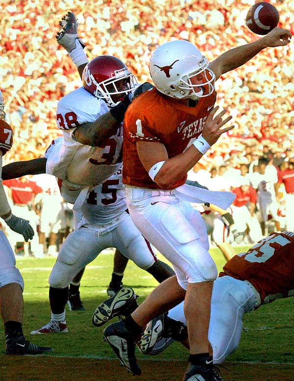 "Oklahoma defensive coordinator Mike Stoops told his star strong safety Williams not to jump. Williams didn't listen. With Texas backed up near its own goal line, a blitzing Williams launched himself over fullback Brett Robin and into quarterback Chris Simms, who tried to throw the ball away but ended up throwing directly to Oklahoma linebacker Teddy Lehman. Lehman danced two yards into the end zone. Williams intercepted Simms' next attempt -- the third consecutive Simms pass to be intercepted -- to cap the Sooners' 14-3 win. ""He's the best defensive player I've ever been around,"" OU coach Bob Stoops said of Williams."