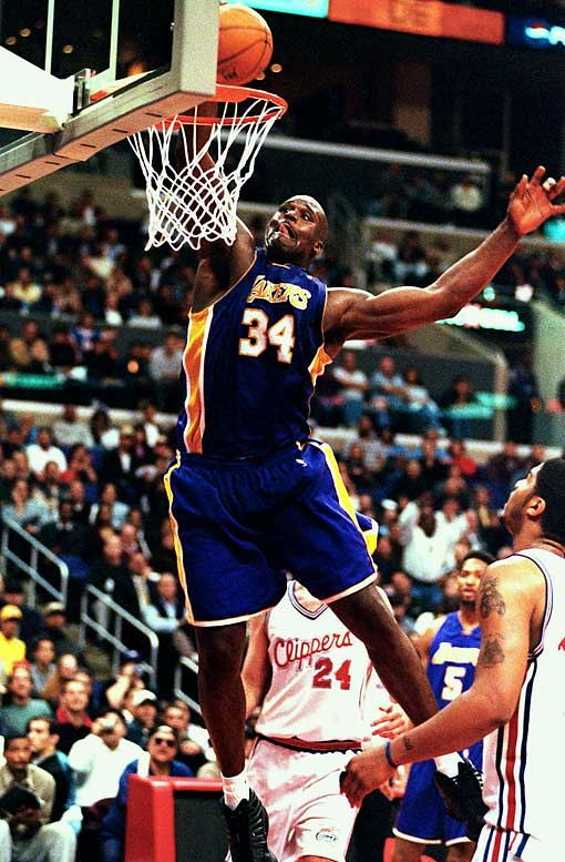 """On his 28th birthday, O'Neal erupted for 61 points and 23 rebounds in the Lakers' 123-103 victory against the Clippers. It was the first 60-20 game since Wilt Chamberlain in 1969. Before the game, the Clippers had denied O'Neal's request for a dozen or so extra complimentary tickets. """"Don't ever make me pay for tickets,"""" Shaq said afterward."""