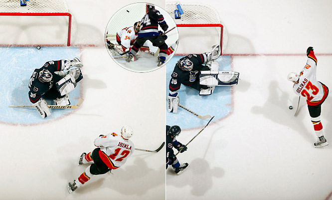 After blowing a 4-0 lead, the Canucks got a goal from Brendan Morrison in triple OT of Game 6 and returned home for their decisive match. Down 2-1 in the final minute and on a power play with their goalie pulled, the Canucks took a cross-checking penalty and watched as Calgary's Jarome Iginla, who had scored twice, narrowly missed an empty net. Incredibly, Matt Cooke jammed home the tying goal off the rebound of a shot by Markus Naslund with only 5.7 seconds left. But the crowd went home unhappy when Calgary's Martin Gelinas scored 1:25 into OT.