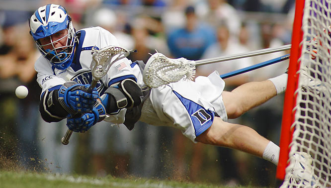 """I was assigned to cover the first Duke lacrosse match after prosecutors dropped all charges against three former players accused of sexual assault the year before. The Blue Devils rallied to beat Virginia 7-6 in overtime. My photo of Max Quinzani taking a wraparound shot was my favorite from the match."""
