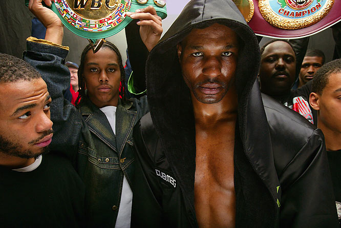 """Over and over again through the years, I'd seen a boxer walking to the ring with his entourage. It's that intense drama preceding a big fight. It's almost like walking to your execution. So I recreated this. I got all of  Bernard Hopkins' handlers in there and all his belts, and we had a casting at his gym. I created a black tunnel with this black cloth, with two lights above, smoke machine and green gels to give it this eerie glow. What makes this picture so terrific are the eyes. This was my first good digital picture, too, so that day was a big transition for me."""