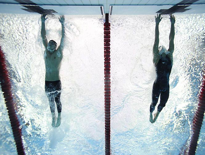 """Underwater shots during competition are difficult and unpredictable, both in terms of where the best graphics will occur and, occasionally, in terms of where the swimmers are seeded. Michael Phelps brought his hands down through the water and touched the wall .01 seconds before Miorad Cavic finished his glide to the wall, swiping the gold medal and tying Mark Spitz's record of seven golds at one Olympics."""