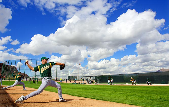 """Spring training is my favorite time of the year, and every February I head down to Arizona to photograph ballplayers getting ready for the regular season. This picture was shot in late February before the games started as the Oakland Athletics were training at their gorgeous training facility, Papago Park, in Phoenix. They have wonderful clouds in Arizona after a rainstorm, and when young pitcher Rich Harden threw a bullpen session, everything lined up for me early one morning."""