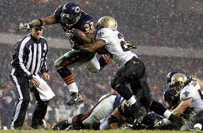 """This is a low-angle shot so Cedric Benson has more of a heroic look as he jumps over the Saints to score during last season's NFC Championship Game. And the snow certainly adds to the picture. This was a fun shoot for me because I grew up in Chicago and the Bears were always my favorite team."""