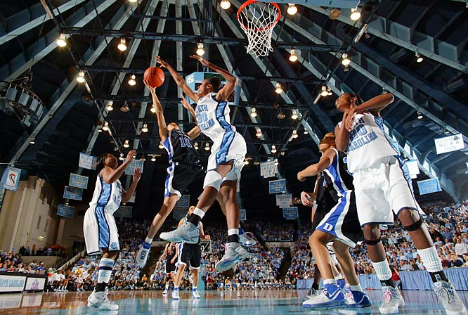 """This shot of the North Carolina-Duke women playing at Carmichael Arena was made from a low-angle remote. I placed one of my remote cameras next to the goal to illustrate the graphical look of the ceiling. Anytime you can create a graphic picture and at the same time the peak action, it offers something special. In this case, the rivalry, action and the graphic nature of the venue all come together."""
