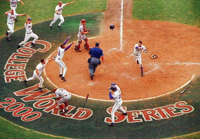"""The College World Series is probably my favorite event to cover. The atmosphere is always charged with enthusiasm, plus the opportunity to make unique pictures at the event is a photographer's dream. In 2000, LSU won the championship over Stanford on the final play of the game. My overhead remote camera captured the thrill of the Tigers' victory."""