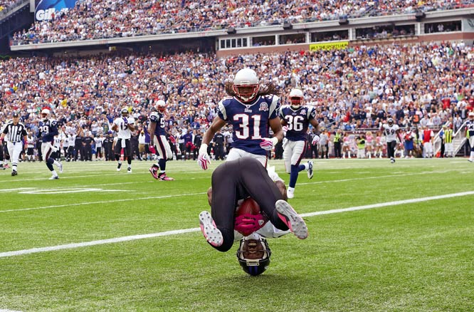 """This photogragh of Derrick Mason is taken literally just 10 or 12 feet away from me in the corner of the end zone. I always try to be ready for plays in the end zone with a short lens around my neck. An earlier collision as he was catching the pass ended up sending him head over heels. It broke right in front of me. Right place, right time."""