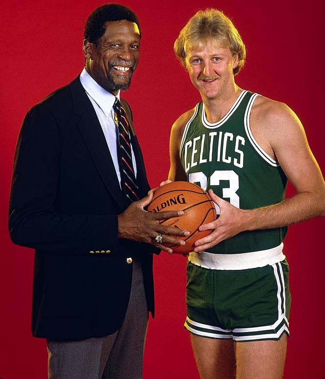 Bill Russell poses with Bird before a preseason game.