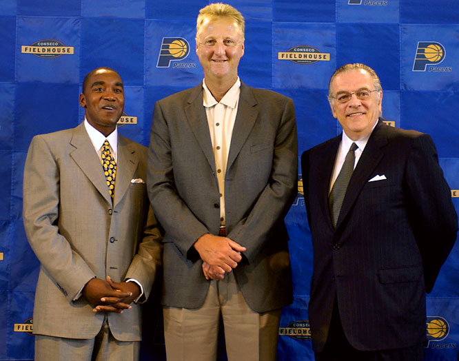 Bird stands with Pacers head coach Isiah Thomas and Pacers CEO Donnie Walsh after Bird was named President of Basketball Operations.