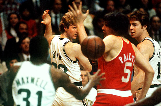Bird tosses a pass behind his back to Cedric Maxwell during a game against the Rockets.