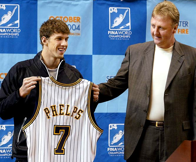 Bird presents Michael Phelps with a team jersey at Conseco Fieldhouse. The No. 7 on the jersey represents the number of gold medals Phelps was expected to compete for in the 2004 Olympics.