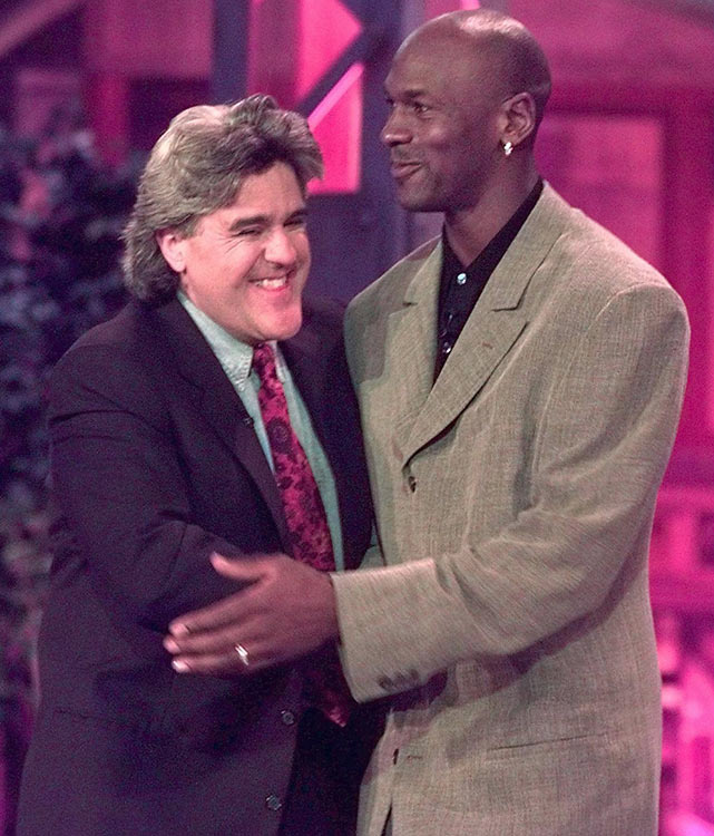 Michael Jordan hugs Leno after being introduced during a taping of The Tonight Show.