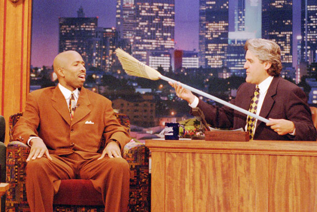 Leno displays a broom to Rockets guard Kenny Smith after Houston swept Orlando to capture the NBA championship.