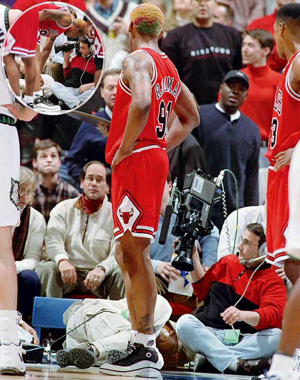 "As much as he was known for his presence on the boards, Rodman was known more for his presence in the headlines. And during a 1997 game at Minnesota, he lived up to his reputation by capping off a 15-rebound performance with what would result in an 11-game suspension. After tripping over baseline cameraman Eugene Amos, Rodman kicked him in the groin so hard that Amos had to be carried off on a stretcher. Afterward, Rodman, who lost an estimated $1 million in salary as a result of his suspension, scoffed at the severity of the incident, saying, ""Maybe I'll send him some roses on the floor."""