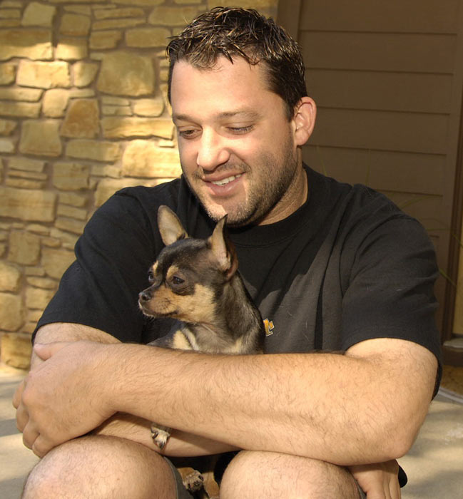 Tony Stewart makes sure to keep his dog close during an SI photo shoot in his hometown of Columbus, Ind.