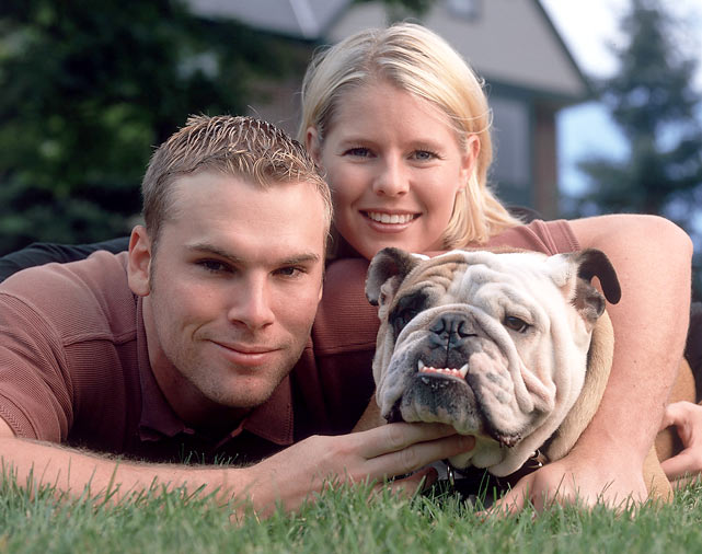 Ben Sheets poses with his wife Julie and dog Bruiser.