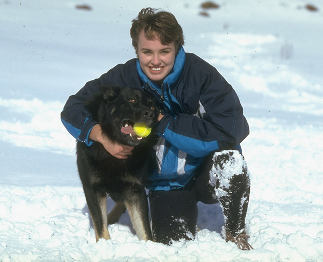 Martina Hingis and her dog enjoy the snowy weather.