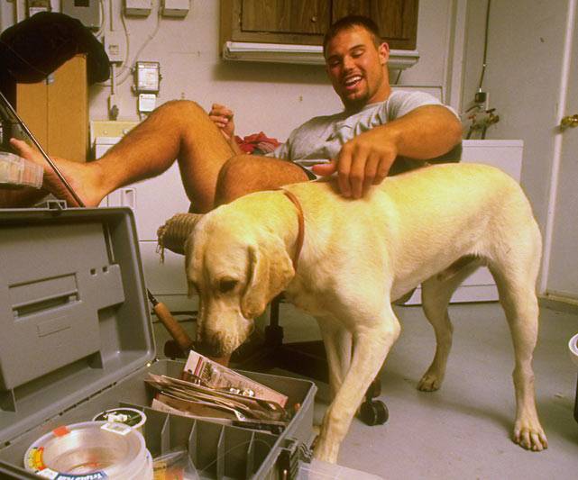 Mike Alstott and his dog get ready for some fishing.