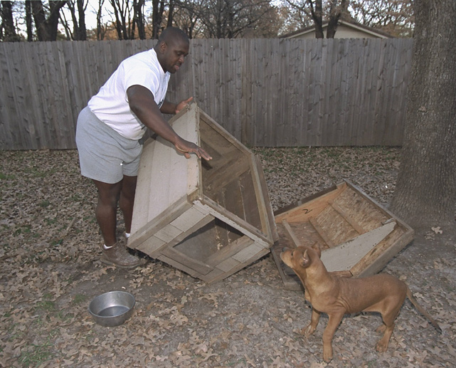 Nate Newton builds a doghouse for his pit bull.