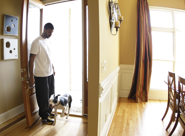 Grizzlies guard O. J. Mayo and his dog Bum hang out at their Memphis house.