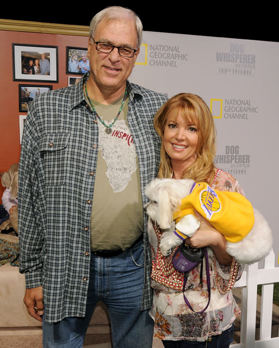 "Phil Jackson, Jeanie Buss and their dog arrive at the 100th episode celebration for the ""Dog Whisperer"" With Cesar Millan. The three appeared on the show in 2008."