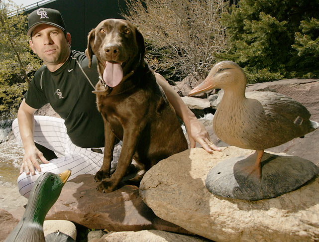 Todd Helton and his dog pose together for a SI photo shoot outside Coors Field.