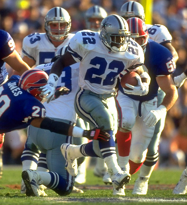 Originally dismissed as too slow and too small for the NFL, Emmitt Smith dominated the league from day one, earning rushing titles in 1991-93 and '95. The three-time Super Bowl champion also holds the league's all-time record for rushing yards (18,355) and rushing TDs (164). In the 1993 season, Smith captured a rare double-double of NFL MVP and Super Bowl MVP.