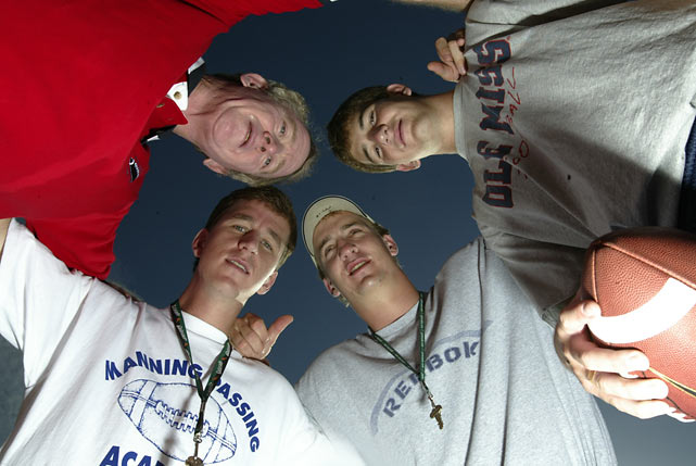 Eli, Peyton, Cooper and Archie huddle at the Manning Passing Academy.