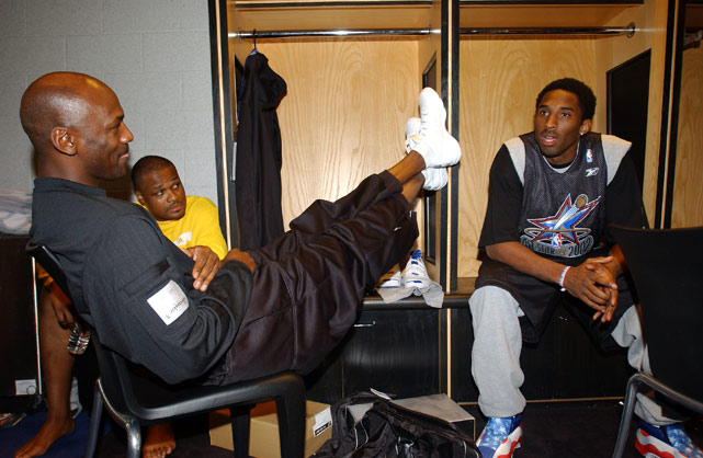 Bryant, of the West All-Star team, talks with Michael Jordan and Antoine Walker from the East team before practice during All-Star weekend in 2002.