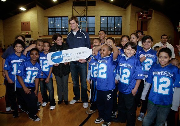 Brady presents a $30k check to the boys and girls of the Boston Centers for Youth & Families. As part of the Zero Sack Give Back initiative, $5,000 was pledged to the BCYF every time Brady made it through an NFL game this past season without being sacked.