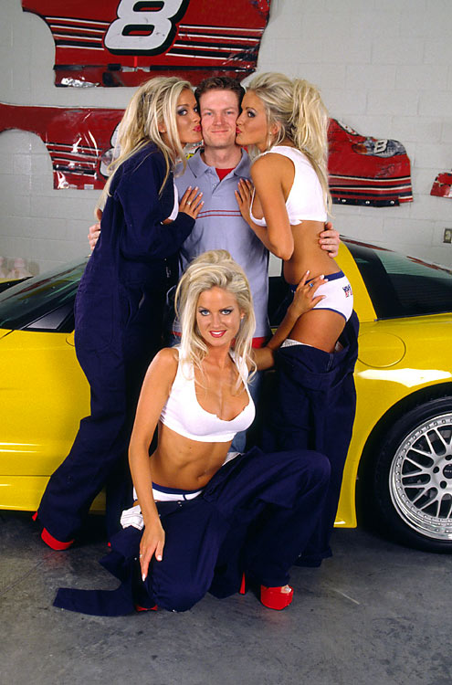 Junior poses with the Dahm triplets on the set of a Playboy shoot.