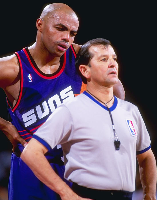 "Barkley ""confers"" with an official during a game against Denver."