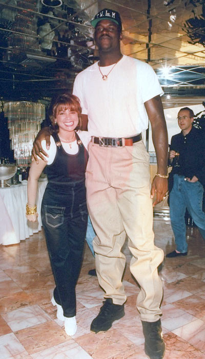 Paula Abdul and Shaquille O'Neal pose at the opening of Planet Hollywood.
