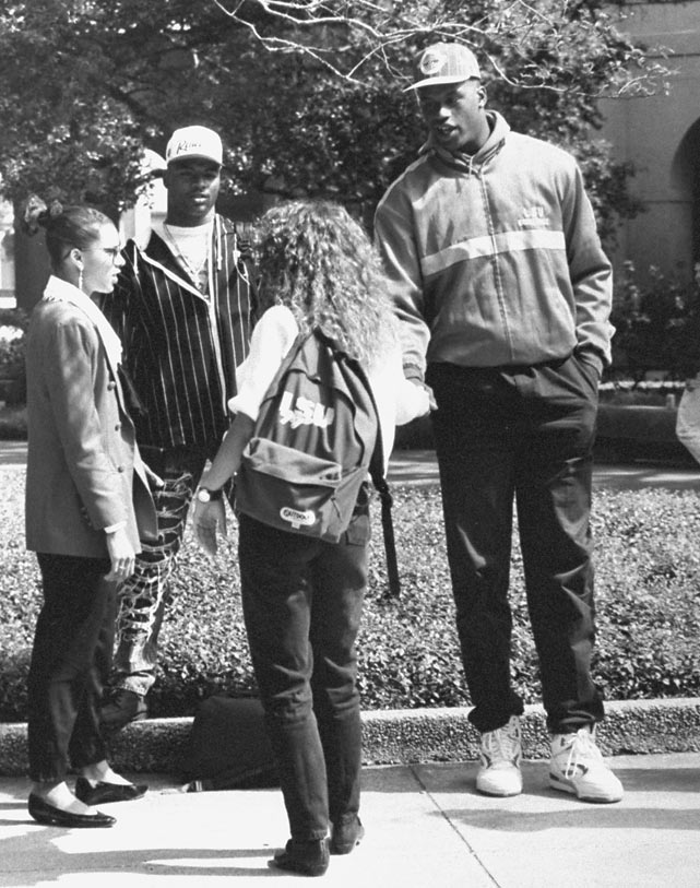 Shaquille O'Neal bonds with some of his LSU classmates in the courtyard.