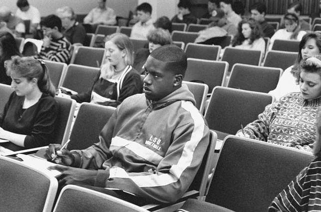 Shaquille O'Neal takes notes at a lecture while at LSU.