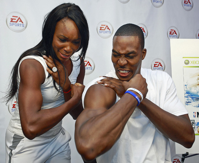 Known for his charity work and appearances off the court, Howard made a stop at an EA Sports event in 2009 so he could show Venus Williams his muscles.