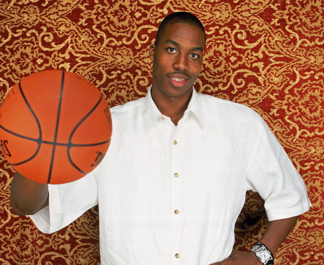 Orlando All-Star center Dwight Howard has quickly made a name for himself in the NBA. After becoming the first overall pick in the 2004 draft, the Atlanta native has a long professional resume, which includes (among many other achievements) two back-to-back Defensive Player of the Year awards, four All-Star appearances, an All-Star Slam Dunk title (an unforgettable one at that) and two Olympic gold medals. <br><br>As he and the Magic look to avenge their 2009 Finals loss this postseason, here's a look some of the big man's best shots ...<br><br>Starting with this one, taken just days before he selected No. 1 in the '04 draft.