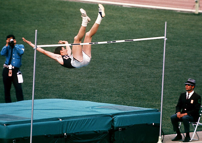 "The first high jumper to jump head first over the bar, the American used the ""Fosbury flop"" to win gold in the 1968 Olympics. His technique captivated the audience, and became the dominant high jumping technique."