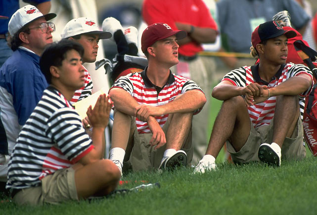 Woods and his teammates watch the action during a tournament at Ohio State.