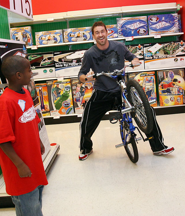 Jaric, then a Timberwolves forward, tries out a bicycle while holiday shopping with kids from the Minnesota Adoption Network.