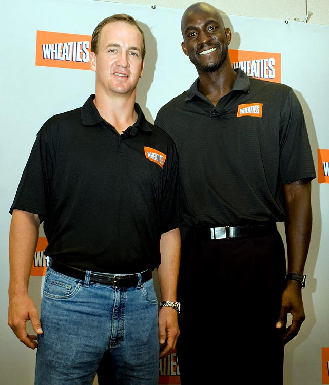 Garnett poses with Indianapolis Colts quarterback Peyton Manning during a promotional press conference for Wheaties.